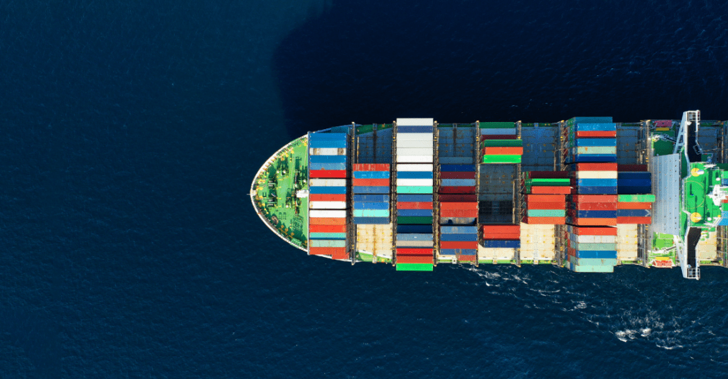 Aerial view of a cargo ship transporting goods by sea.