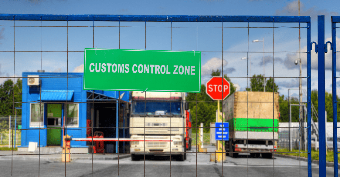 Trucks passing through a customs clearance zone.